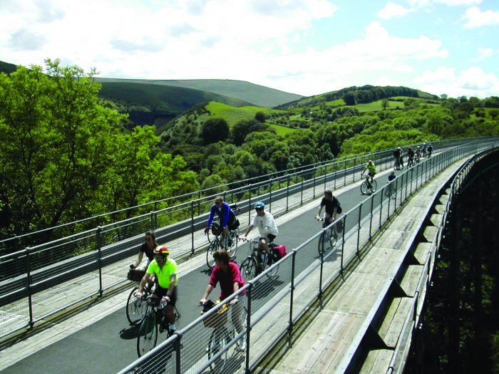 Cyclist riding along viaduct